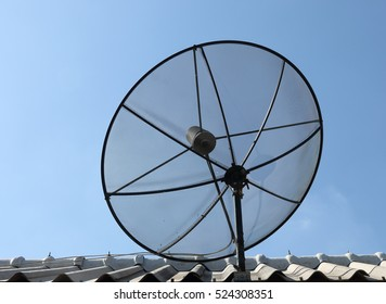Satellite Dish on the roof and blue sky background,communication concept