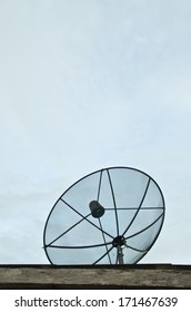 satellite dish on the roof, sky background