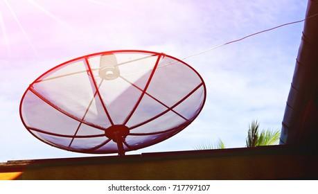 Satellite Dish Pointing Against Sun Flare