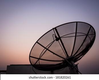 Satellite dish with sunset background