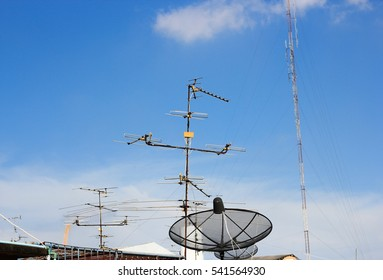 Satellite Dish and TV antenna with blue sky background