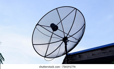 satellite dish and TV antennas on the house roof.