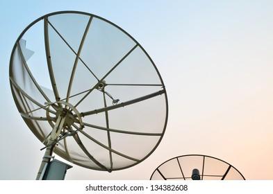 Satellite dish at twilight