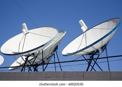 satellite dishes, cables and blue sky background