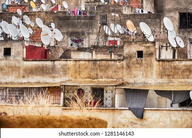 Satellite dishes cluster on the rooftops of the houses in the old city, or medina, of Fes in Morocco.