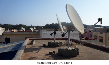 Satellite dishes on the rooftop at the beginning of the morning