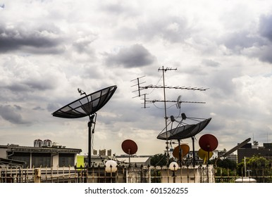 Satellite dishes on a rooftop of the building