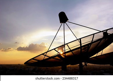 Satellite dishes on twilight sky background