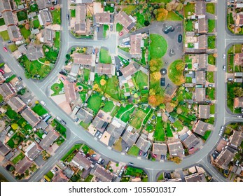 Satellite image style aerial view of homes on an English housing estate. Looking straight down on streets and houses with community and social concepts
