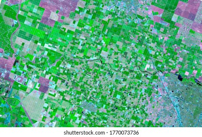 Satellite images in false-color compositions showing crops between the ash and wood boundaries California USA.