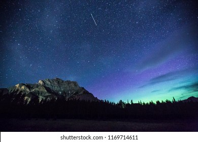 Satellite & northern lights in the night sky near Banff, Alberta. Captured in July, 2018.