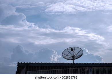 satellite on the roof with cloud and blue sky background,vintage style