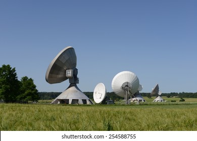 Satellite system on green meadow against the blue Sky