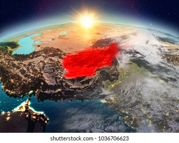 Satellite view of Afghanistan highlighted in red on planet Earth with clouds during sunrise. 3D illustration. Elements of this image furnished by NASA.