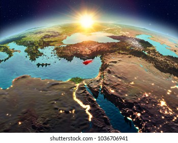 Satellite view of Cyprus highlighted in red on planet Earth with clouds during sunrise. 3D illustration. Elements of this image furnished by NASA.
