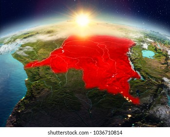 Satellite view of Democratic Republic of Congo highlighted in red on planet Earth with clouds during sunrise. 3D illustration. Elements of this image furnished by NASA.