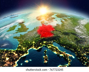 Satellite view of Germany highlighted in red on planet Earth with clouds during sunrise. 3D illustration. Elements of this image furnished by NASA.