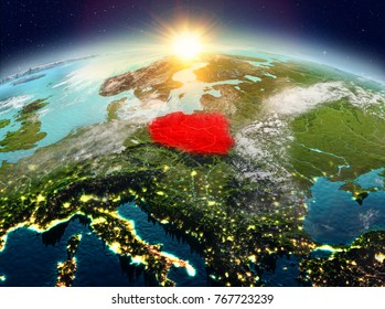 Satellite view of Poland highlighted in red on planet Earth with clouds during sunrise. 3D illustration. Elements of this image furnished by NASA.