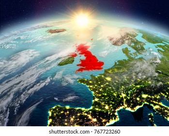 Satellite view of United Kingdom highlighted in red on planet Earth with clouds during sunrise. 3D illustration. Elements of this image furnished by NASA.