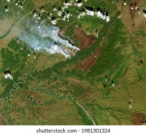 Satellite view of the wildfires in a field. Elements of this image furnished by NASA.