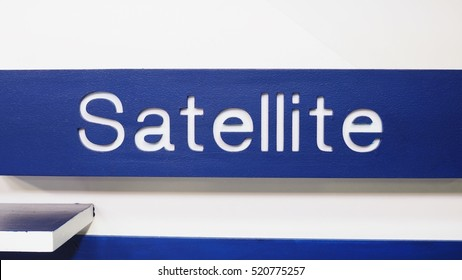 Satellite - word on blue background