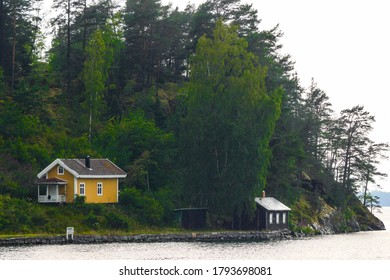 Sater, Sweden July 25, 2020 A small island with summer houses in the rain.