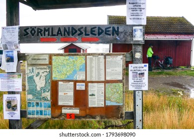 Sater, Sweden July 25, 2020 A sign for the Sormlandsleden, a walking trail and a bicyclist.