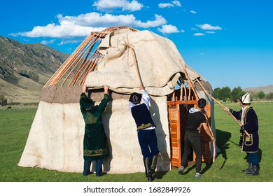 Sati, Kazakhstan – September 07, 2016: Kazakh men putting up a yurt, Sati village, Tien Shan Mountains, Kazakhstan