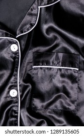 Satin Pyjamas, a black smooth elegant satin texture, can be used as abstract design background, fabric pattern