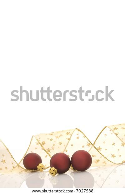 satin red balls and golden ribbon