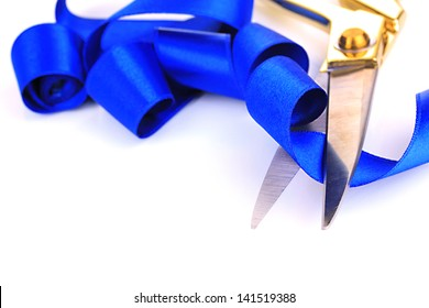 Satin ribbon curled around scissors isolated on white