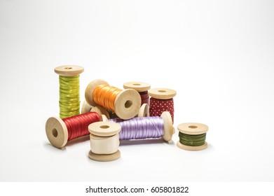 Satin ribbon on wooden spools