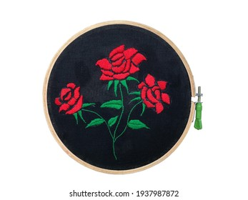 Satin stitch decorations on the black fabric in wooden frame, a satin stitch or damask stitch is a series of flat hand stitches that are used to completely cover a section of the background fabric.