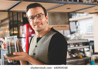 Satisfied barista keeping brew of tea