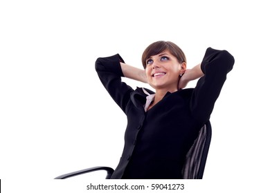 Satisfied business woman with hands crossed behind her head with look of success