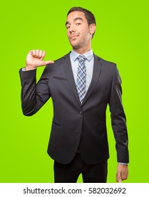 Satisfied businessman doing a victory gesture