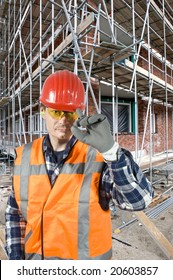 A satisfied and confident construction worker touching his hard hat with his finger, greeting the customer