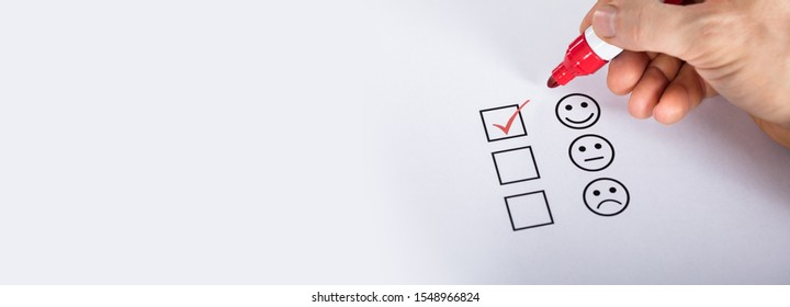 Satisfied Customer Putting Check Mark On Quality Service Survey Checklist Next To Drawn Happy Face