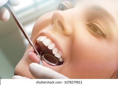 Satisfied dentist patient showing her tooth