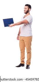 Satisfied latino man with beard gives a folder. He gives it to someone. Wears beige pants and trendy t-shirt.