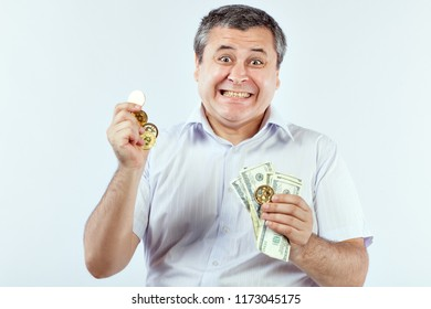 Satisfied man with bitcoins and dollars in his hands. He likes crypto currency.