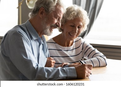 Satisfied senior couple at lawyer office signing prenuptial agreement marriage articles, 70s spouses make decision buying medical life health insurance, concept of testament last will and inheritance