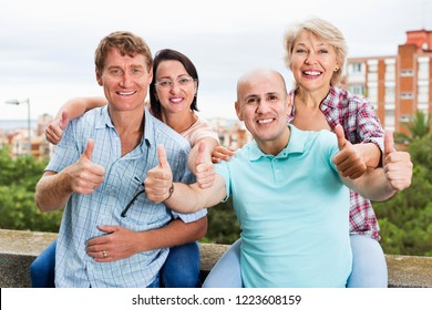 Satisfied smiling  mature couples of pensioners on weekend together