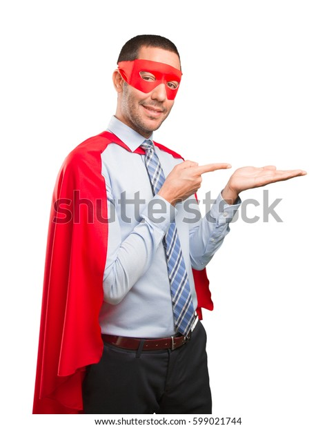 Satisfied super businessman showing