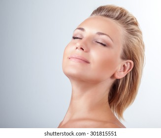 Satisfied woman at spa, portrait of beautiful female with closed eyes of pleasure over light background, natural cosmetics, enjoying day at spa salon
