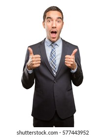 Satisfied young businessman doing an approval gesture