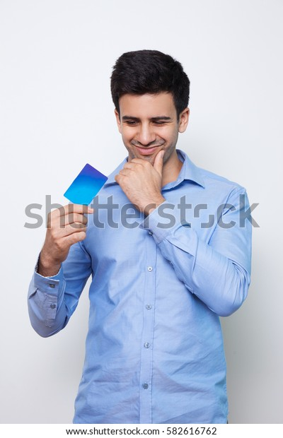 Satisfied Young Handsome Man Holding Credit Card