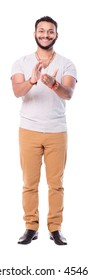 Satisfied young man with beard applauds with both hands. Wears beige pants and trendy t-shirt. Isolated on white background. Full length.