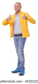 Satisfied young man shows thumbs up gesture. Looks cheerful and positive. Full length cutout photo. Isolated on white background.