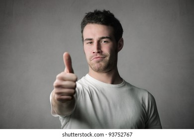 Satisfied young man with thumbs up